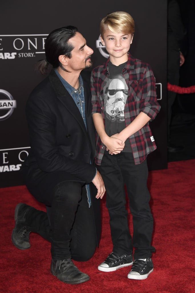 """The guys of the Backstreet Boys have come a long way since their oversize suits and matching Matrix-esque looks, but they're still as close as ever. On Saturday, Kevin Richardson and AJ McLean made dreams come true when they reunited at the LA premiere of Rogue One: A Star Wars Story. Kevin brought along his 9-year-old son, Mason, and they all gathered on the red carpet for pictures. In addition to snapping photos, AJ shared a few shots from the event on Instagram, including one of him posing with Darth Vader, writing, """"What up Vader? How's your mom???"""" While the Backstreet Boys have been busy performing at a series of Jingle Ball concerts throughout the past couple of weeks, they're also gearing up for their Las Vegas residency, which kicks off on March 1, 2017 at The Axis at Planet Hollywood Resort & Casino."""