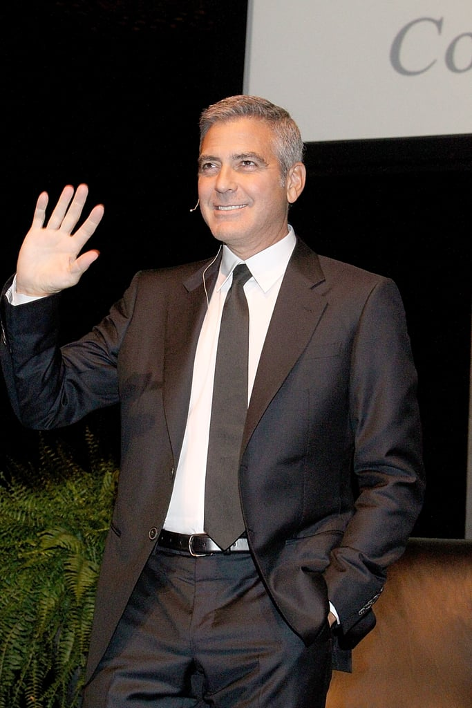 George Clooney waved before being interviewed in Houston.