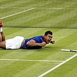 France's Jo-Wilfried Tsonga of France celebrated from the ground during his tennis match against Thomaz Bellucci of Brazil.