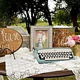 Typewriter and Wooden Signs