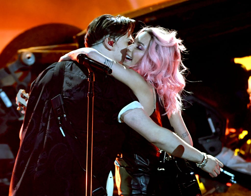 "By now, you've probably heard that Halsey and Yungblud are dating! After much speculation, the 24-year-old singer made their relationship Instagram official when she posted a cute photo of the pair in January, and most recently, they teamed up for their latest hit, ""11 Minutes,"" featuring Travis Barker. The chemistry between Halsey and the 21-year-old rocker is undeniable, but how exactly did these two meet?  Well, they have Instagram to thank for their romance. ""She sent me her number on an Instagram DM. That's it!"" Yungblud revealed in an interview with 97.1 AMP Radio. ""I was like, 'That's so cool.' I was just in the studio with my mates and I was like, 'Halsey just gave me her number and a black heart.'"" ""I'm 24, he's 21, I'm a cougar, I get it,"" Halsey added. I mean, age is just a number, right? See the couple's cutest moments ahead!"