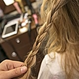 Take a small section of hair that's slightly to the left of the center of the back of your head and create a loose regular braid.