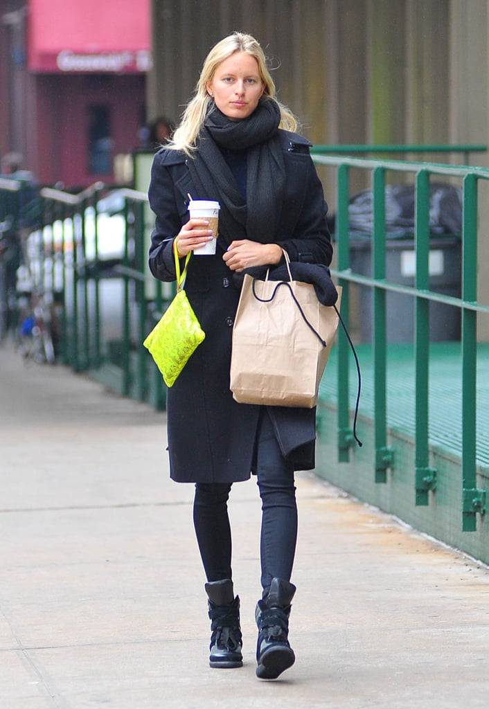 Karolina Kurkova's black ensemble, complete with Monika Chiang sneakers, was given a major pop of bright thanks to her neon-yellow wristlet.