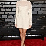 Allison Williams was ladylike in a long-sleeved sheer off-white mini-dress and Christian Louboutin 'So Kate' pumps in Rouge Noir.