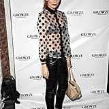 Mischa Barton sported a sexy, sheer polka-dot blouse with a black bra and leather pants. It was '60s-inspired with a drop of Cher Horowitz, making for a cool, unexpected nighttime look.