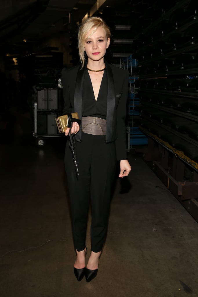 Carey Mulligan jazzed up her all-black Lanvin ensemble with a gold box clutch and matching metal choker at the Grammy Awards in LA.