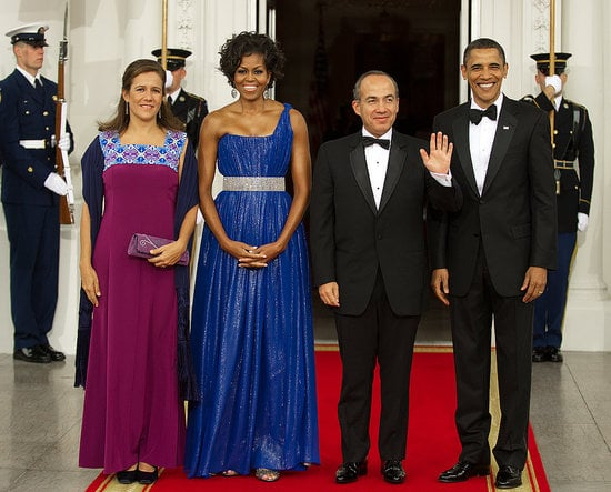 Michelle wore a bright blue, one-shoulder Peter Soronen gown for a presidential event.
