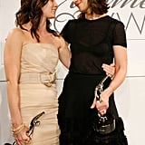 Katie Holmes posed side-by-side with Emily Blunt at Elle's Women in Hollywood event in October 2009.