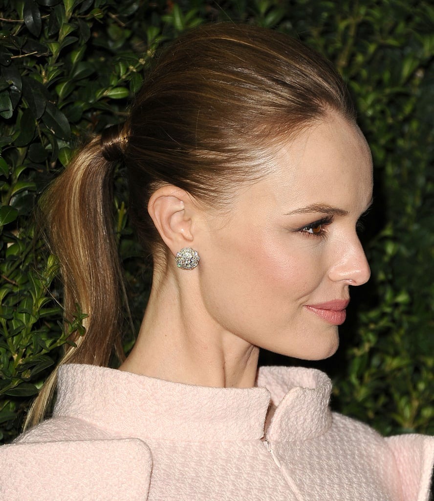 One way to make your average updo more formal is to add a piece of hair around the elastic à la Kate Bosworth at Chanel's Pre-Oscar dinner.