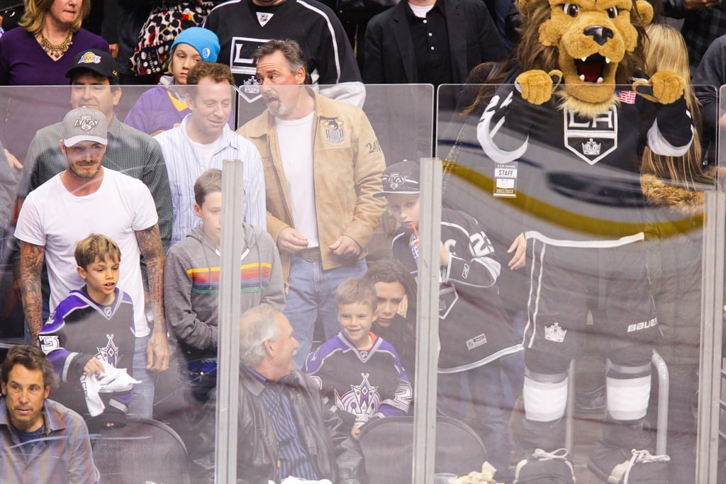 David Beckham, Victoria Beckham, and family watched the playoff hockey game together at the Staples Center in LA.