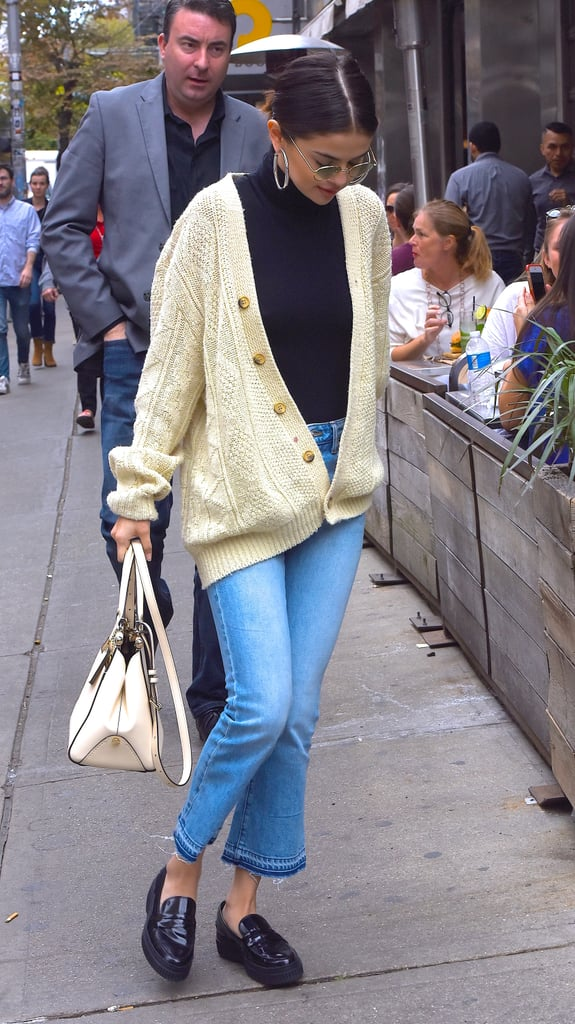 463f1d16bc8 Selena styled an oversize cardigan with gold buttons with a dark  turtleneck