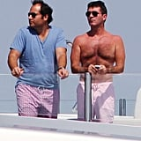 Simon Cowell chatted with a friend on deck.