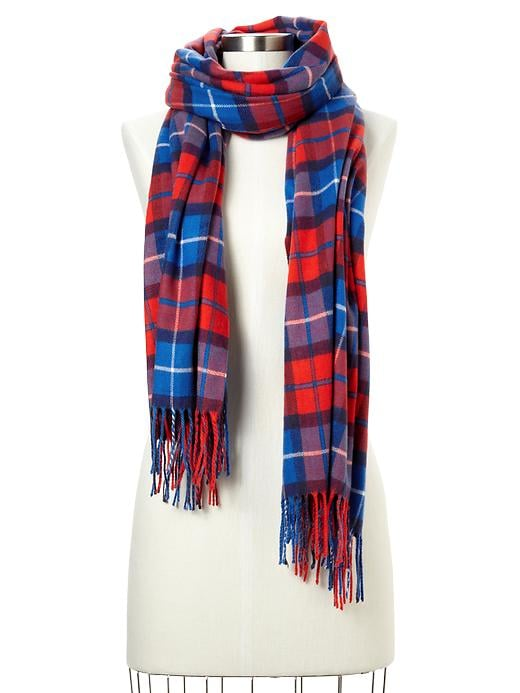 A little bit lumberjack, a little preppy chic — Gap's red plaid scarf ($30) captures more than one essential Fall mood.