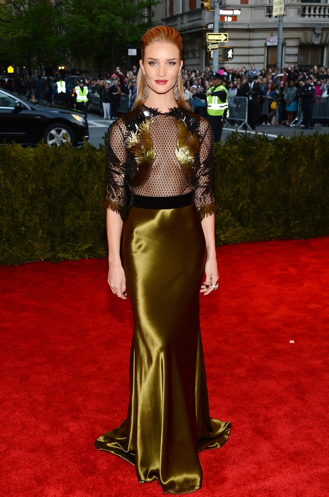 Rosie Huntington-Whiteley looked stunning in a black-and-gold netted Gucci gown that she paired with ruby nails and a Lorraine Schwartz ring.