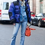 A Puffer Jacket Over a Denim Jacket and Bootleg Jeans
