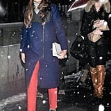 Even in the snow, this styler kept it together with bright color, great outerwear, and cool-girl booties.