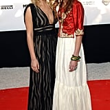 Twinning combo: The girls offset their grown-up gowns with sweet, tousled curls for an amfAR event in 2005.  Ashley  glowed in a plunging striped gown with minimal accessories.  Mary-Kate added a pop of color to her tiered crepe dress with a cropped red satin jacket and a few bangles.