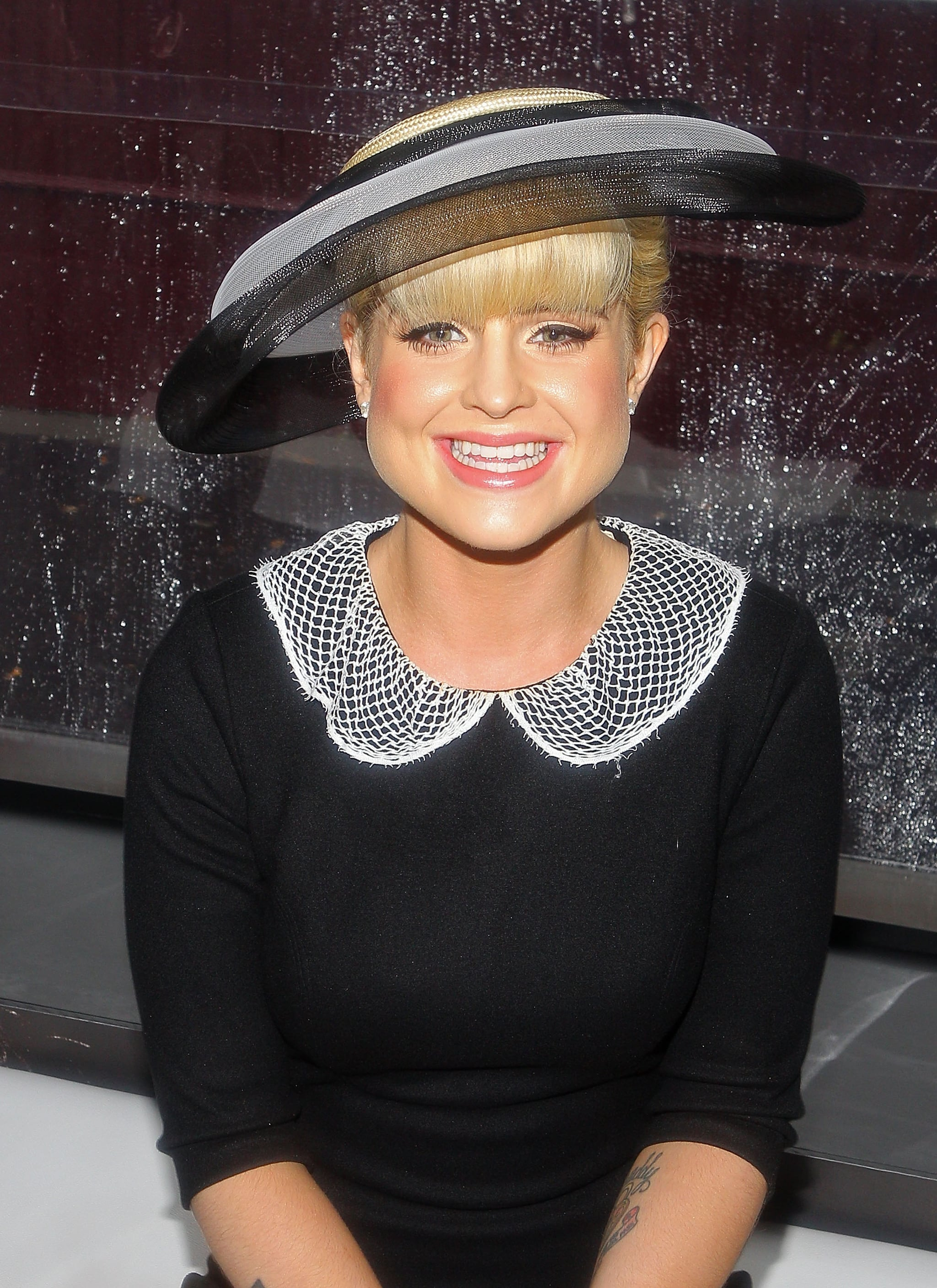 All smiles Kelly. Love that peter pan collar!