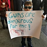 Kids Holding Signs at March For Our Lives