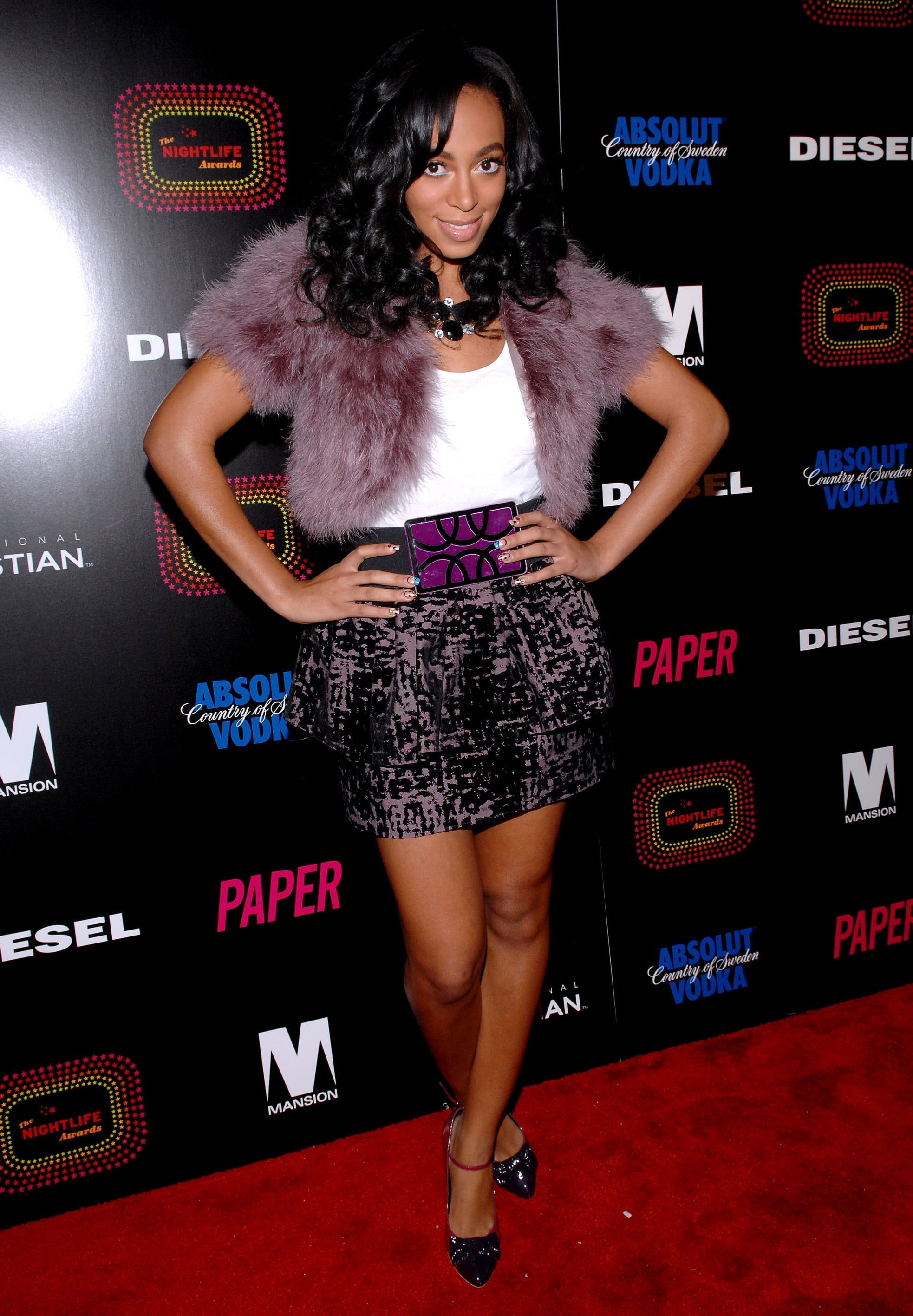 For the fourth annual Nightlife Awards, Knowles stepped out in a printed miniskirt, purple fur shrug, and a coordinating belt.