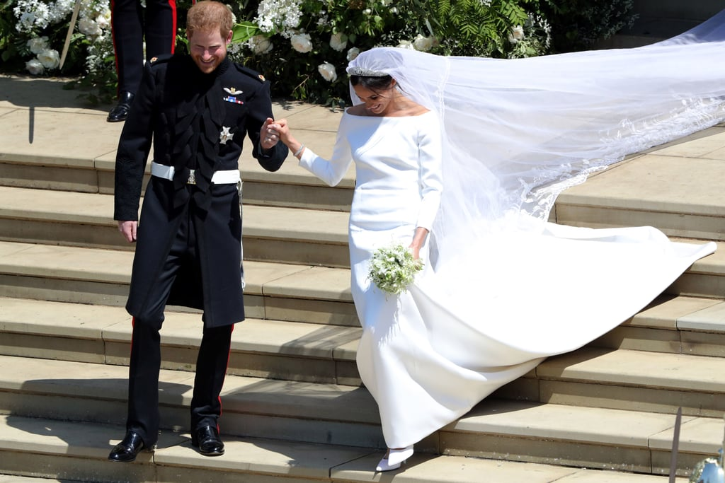 In the spring of 2018, Meghan Markle wed Prince Harry and officially became the Duchess of Sussex. For the occasion, she wore a stunning gown by Clare Waight Keller for Givenchy with a pair of satin pumps.  With an open bateau neckline and slim three-quarter sleeves, Meghan's dress looked exactly like what we imagined — if not better. Accessorized with a diamond-encrusted bandeau tiara, sparkling jewels, and a cathedral-length veil, which represented the distinctive flora of each Commonwealth country, it was one of the most breathtaking royal wedding dresses we have ever seen. Read on to see Meghan's extraordinary dress in more detail.      Related:                                                                                                           100+ Times Harry and Meghan Showed Us That They're the Perfect Royal Match