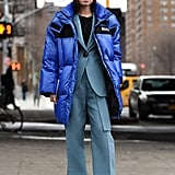 Winter Outfit Idea: A Suit Worn With a Puffer Jacket