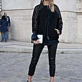 Black, but not so basic, thanks to visor-style shades and a varsity-inspired topper.