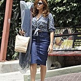 Eva Mendes is our tie-front-top expert. Her daisy-printed ASOS top looked supercute against a high-waisted denim pencil skirt and her go-to Christian Louboutin espadrille wedges.