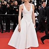 Eva Herzigova chose a chic white fit-and-flare Dior dress and Chopard jewels for The Unknown Girl's premiere.
