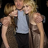 Mary-Kate Olsen, Robert De Niro, and Ashley Olsen got close at the third annual Tribeca Film Festival New York Minute premiere in May 2004.