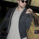 Robert Pattinson left LA on a flight reportedly headed for Germany.