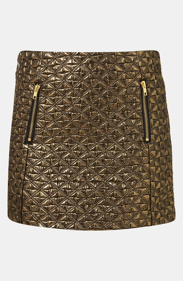 """While this mini has """"holiday party"""" written all over it, it would look pretty adorable for day, tempered with a plaid button-down, tights, and booties. Topshop Metallic Jacquard Miniskirt ($80)"""