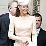 Kate finished the look with a creamy, coordinating fascinator and delicate drop earrings.