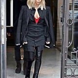 Kim Suited Up in a Givenchy Menswear Pinstripes Look and Her Favorite Leather Boots For an Outing With Kanye
