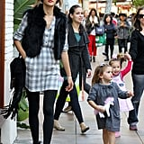 Alessandra's Fall-chic look: a plaid dress with a fur vest, fringe bag by JJ Winters, black tights, and black booties.