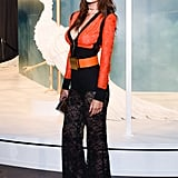 Emily turned to the side, showing off her chunky statement belt and lacy wide-leg pants.