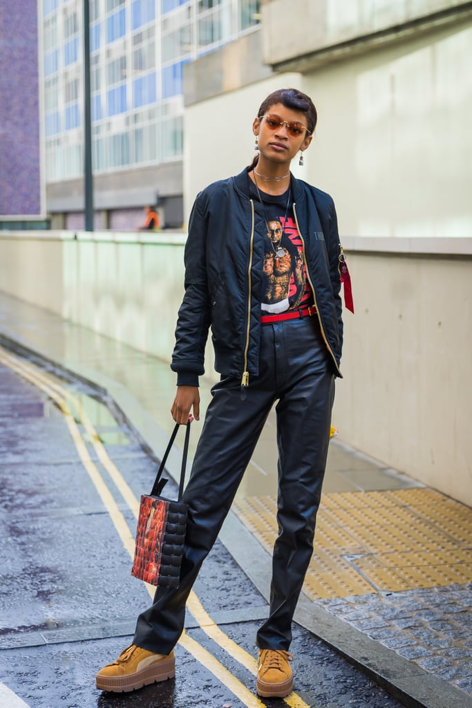 Work a straight leg pair with a bomber jacket, graphic t-shirt, and platform sneakers or boots.