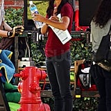 Courteney Cox held onto her water and script.