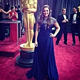 Our fashion reporter Allison McNamara posed next to an Oscar statue while preparing for the Oscars. Source: Instagram user allisonmcnamara