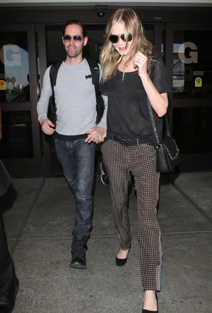 Kate Bosworth arrived at LAX hand in hand with fiancé Michael Polish yesterday. Kate and Michael returned to the West Coast after a busy week in NYC, where they attended many shows and events for NYFW. On Monday, Kate and Michael sat front row at Theyskens' Theory, and last week she stepped out solo to celebrate the opening of Proenza Schouler's store with designers Jack McCollough and Lazaro Hernandez. At the bash, Kate interviewed Proenza Schouler's Jack and Lazaro, too. Her and Michael's stay wasn't all about fashion, though, since they visited Ground Zero on Tuesday in honor of the 11th anniversary of 9/11.