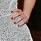 When it came to her nails, Lisa Postma painted Emilia's paws with Sally Hansen Complete Salon Manicure in Wine Not ($8) and finished with Sally Hansen Complete Salon Manicure Dry + Go Drops ($8).