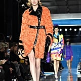 Gigi Wore an Orange Shearling and Leather Coat at Moschino