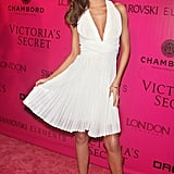 The model had a Marilyn moment in a flowing white halter at a Victoria's Secret Fashion Show 2011 afterparty in NYC.