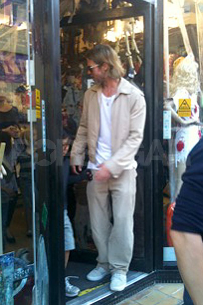 Brad Pitt out shopping in London with his kids.