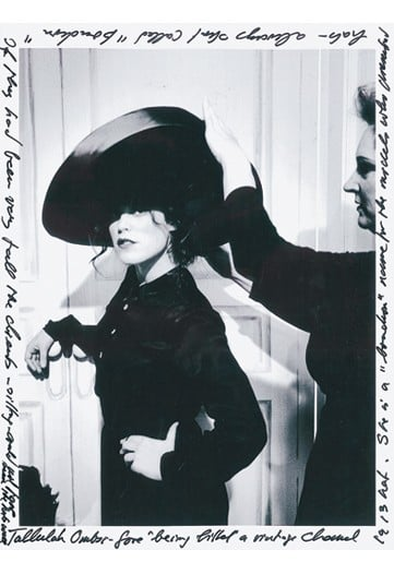 Tallulah Ormsby-Gore, as a model being fitted in a vintage 1913 Chanel hat.
