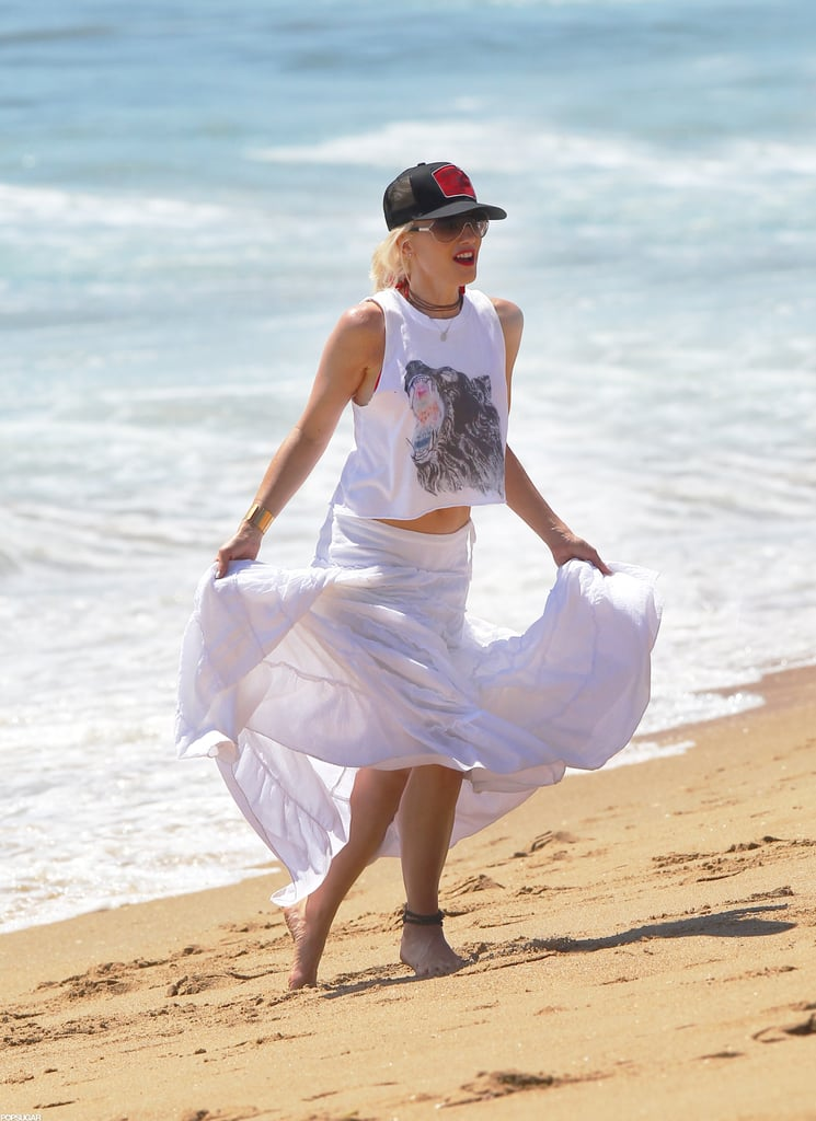 Gwen Stefani wore a white skirt and trucker hat on the beach.