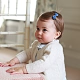 Princess Charlotte on Her First Birthday Wearing Prince George's Cardi