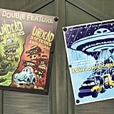 Halloween movie posters are hung around Cars Land.