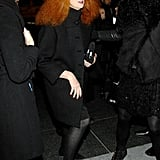 Grace Coddington steps out in a classic, black coat and flats.