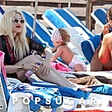 Gwen Stefani relaxed on the beach, while her boys hit the water.